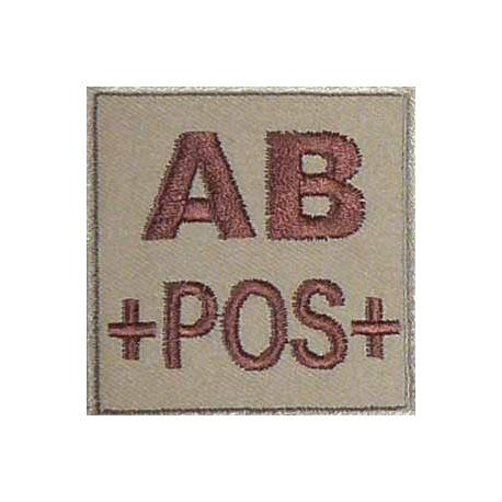 Groupe sanguin AB positif brodé sur tissu tan