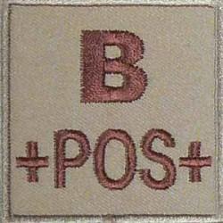 Groupe sanguin B positif brodé sur tissu tan