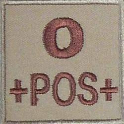 Groupe sanguin O positif brodé sur tissu tan