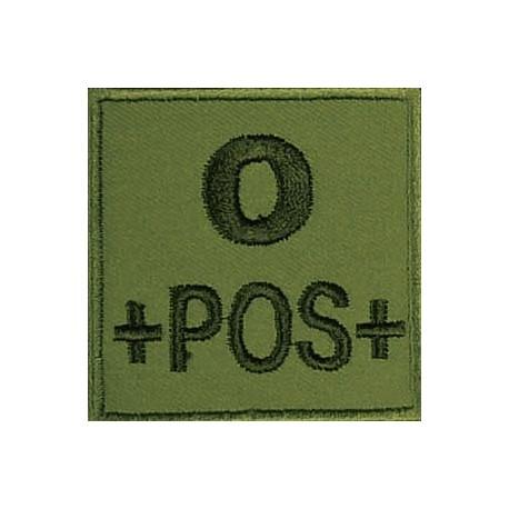Groupe sanguin O positif brodé sur tissu vert OD